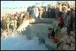 Kadhafi assiste à une cérémonie de l'eau au sud de Tripoli le 18 août 2007 (© AFP/Archives - Mahmoud Turkia)
