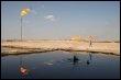 Champ pétrolier près de Bassorah en Irak  le 3 février 2009 (© AFP/Archives - Essam al-Sudani)