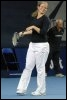 La Belge Kim Clijsters jouant un double mixte pour une oeuvre de charité à Luxembourg le 23 septembre 2007 (© AFP/Archives - Nicolas Bouvy)