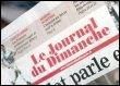 Le journal du dimanche (© AFP - OLIVIER LABAN-MATTEI)