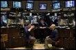 Des traders à la Bourse de New York le 18 mars 2009 (© AFP/Getty Images - Spencer Platt)