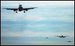 Des avions attendent d'atterrir à l'aéroport de Londres Heathrow le 16 décembre 2003 (© AFP - Adrian Dennis)