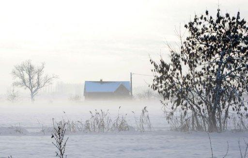 Une ferme isolée le 20 décembre 2010 à La Couture (©  - Denis Charlet)