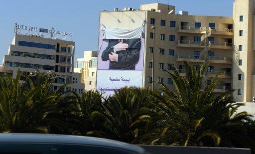 Portrait de Ben Ali arraché le 16 janvier 2011 dans une banlieue de Tunis (©  - Fethi Belaid)